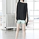 Add a hint of off-kilter styling to your pastel shorts by sporting them with a black statement top.