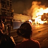 London residents watch the residential fires during the riots.