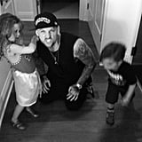 Joel Madden caught his brother, Benji, playing on the floor with Harlow and Sparrow. Source: Instagram user joelmadden