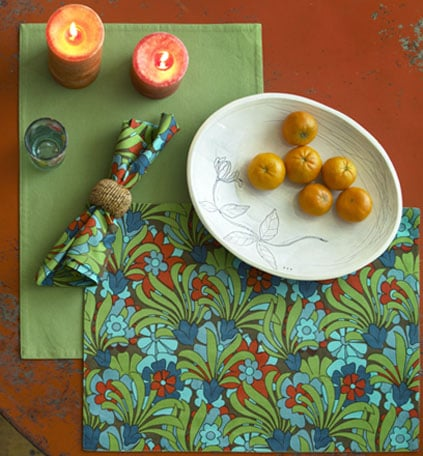 The India Rose Wally Cool Placemat Set ($36.95 for six) has the perfect mix of warm and cool tones and billowing botanicals to usher you into Fall. In the mood for something simple? The 100 percent cotton twill placemats reverse to solid olive.