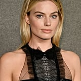 Margot Robbie as Kayla Pospisil