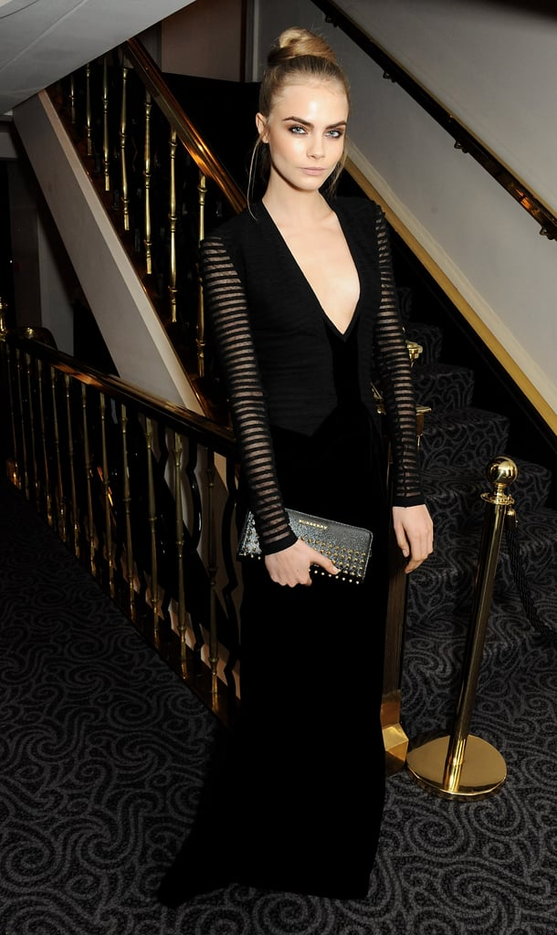 Cara Delevingne donned a gorgeous sheer-sleeved Burberry dress paired with a studded Burberry clutch at the London Evening Standard Theater Awards.