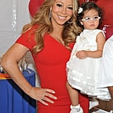 Mariah Carey wore a red dress while she posed with Monroe Cannon.