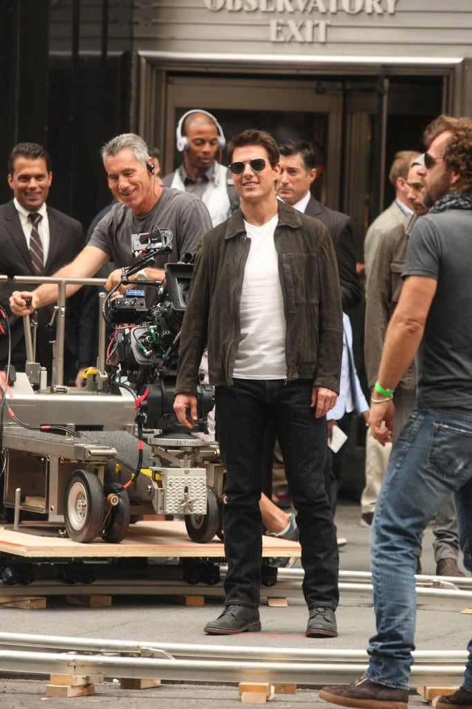 Tom Cruise reported to the set of Oblivion in NYC this morning. He got into character for the action movie, which was previously being shot in New Orleans, after spending the weekend on another project. Tom promoted Rock of Ages with premieres in LA and London alongside his costars Julianne Hough and Russell Brand. While doing press, Tom joked about keeping a bejeweled item from the set and gifting it to Katie Holmes. Katie didn't join Tom on the red carpet, since she's been busy in Asia as an ambassador for Artistry on Ice. She may, however, be back in Manhattan in time to celebrate her husband at a special event tonight. Tom is being honored by the Friars Club with the Entertainment Icon Award at the Waldorf Astoria tonight. He may have another title under his belt soon if he takes the lead in the PopSugar 100. There are only a few days left to vote so play now!