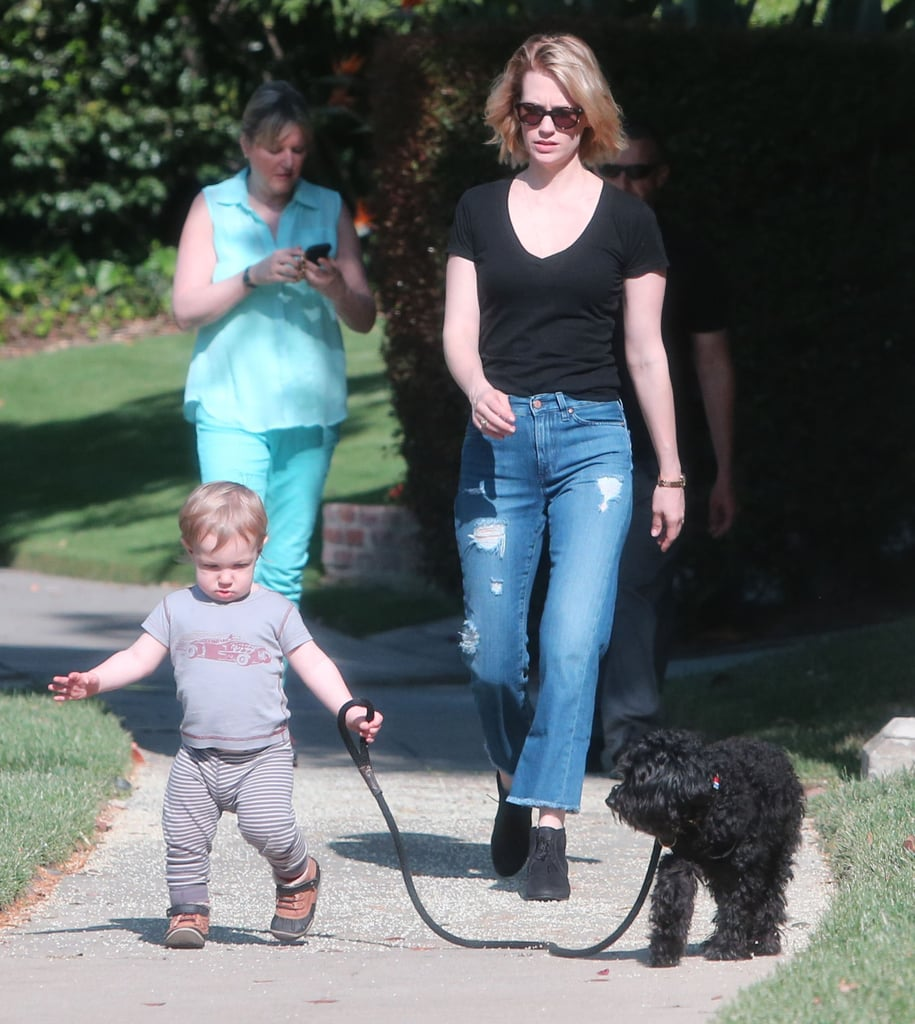January Jones let her son, Xander, take their little dog for a walk in LA on Sunday.