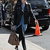 For an outing in SoHo, Gigi elevated black pants with oxfords and a luxe bag in tow.