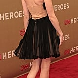 Emma Roberts gave a glimpse at the back of her dress and her towering heels.