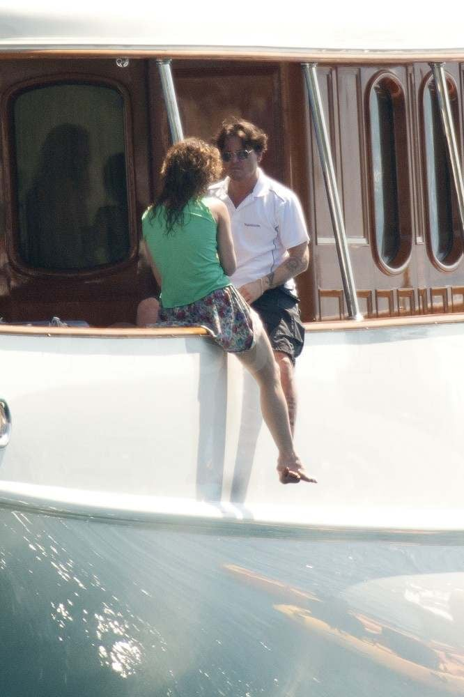The duo chatted on the side of their yacht in August last year.