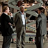 Christopher Nolan, Morgan Freeman, and Christian Bale on the set of The Dark Knight Rises.