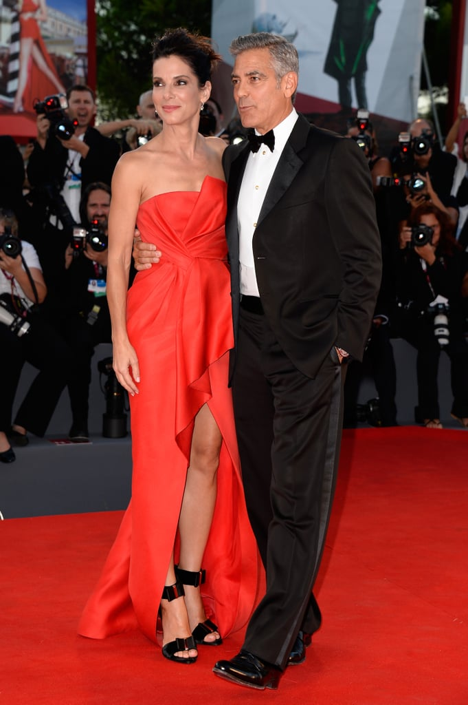 At the Venice International Film Festival premiere of Gravity, Sandra Bullock paired her red J. Mendel column with handsome extras: Roger Vivier accessories and George Clooney.