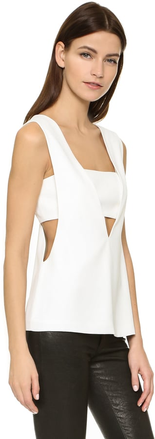 """The Tank: Alexander Wang Low V Bandeau Tank ($375) The Glowing Review: """"This top was my first foray into the 'cutout' trend. As a nearly 40-year-old mom to a toddler, I'm not into showing tons of skin, but I gave this top a try and I'm so glad. I ordered two sizes (small and medium) and went with the small, but it is important to get the size right on this one. The bandeau closes with tiny metal hooks so you want to make sure that it's not too loose or too tight. I paired this with some skinny black jeans when in Miami recently and it was such a fun nighttime look. This probably isn't a top you'll wear all the time, but it's cut fabulously and the fabric is substantial so I felt it was a good purchase."""""""