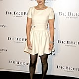 Simple and elegant, this white Dior dress could also be similar to her wedding dress.