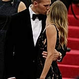 Gisele and Tom stole a handful of kisses.