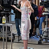 While on Good Morning America, Miranda Kerr sported a print dress with a pair of Casadei's orange suede Blade pumps.