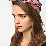 Perfect for beach-bound days or just as a cute hair accessory, this delicate floral knotted headband will add dynamic to your outfit as well as your hairdo. Urban Outfitters Knot Bow Headwrap ($16)