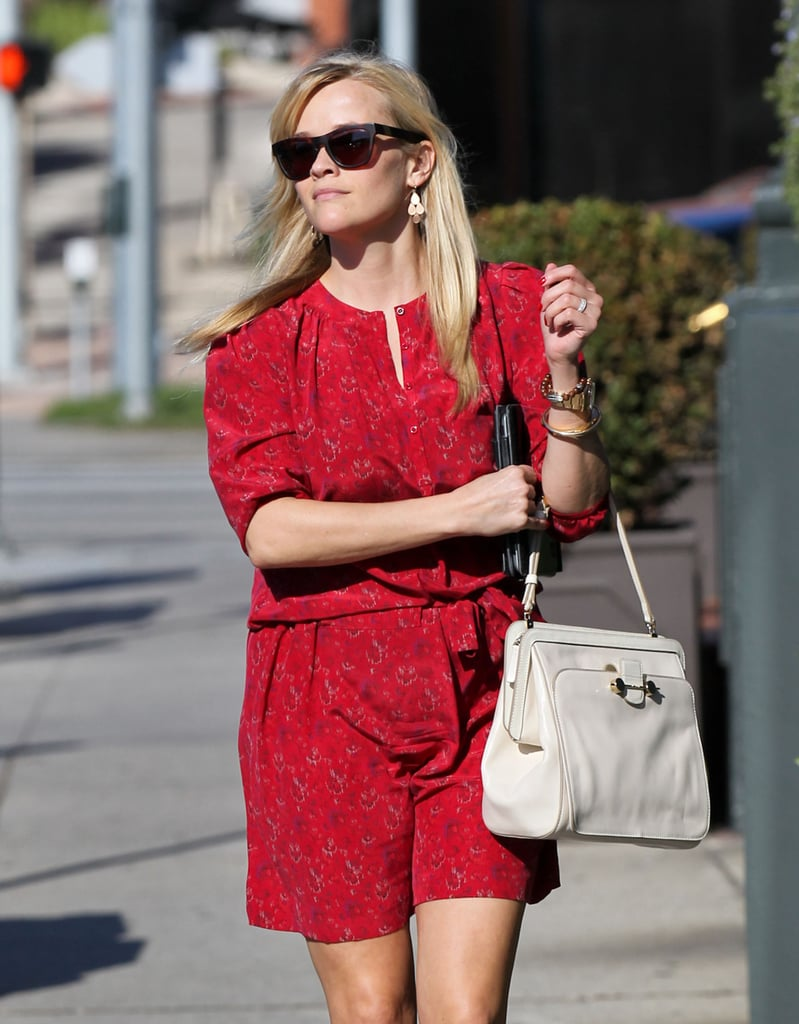 Reese Witherspoon showed off her waistline with a cinched dress.