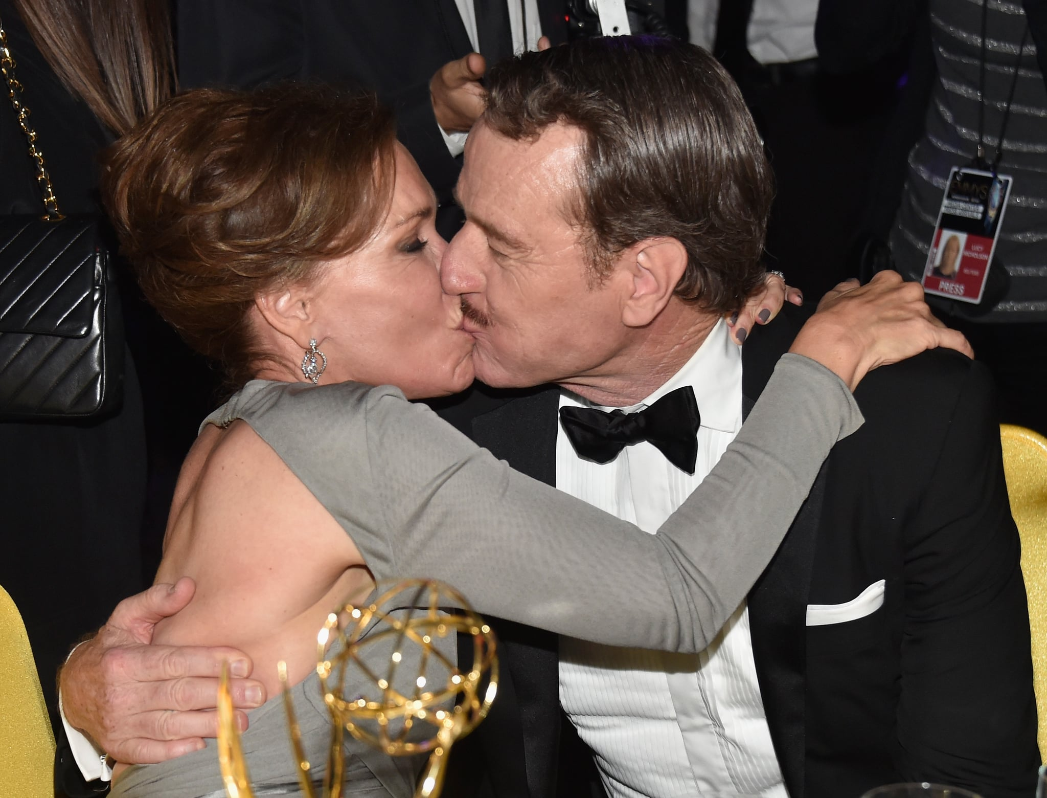 Bryan Cranston planted a kiss on his wife, Robin Dearden, during the Governors Ball.