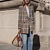 Business casual? How about cool-girl casual. The combo: wide-leg jeans, a punchy plaid blazer, t-shirt, smart bags, and heels.