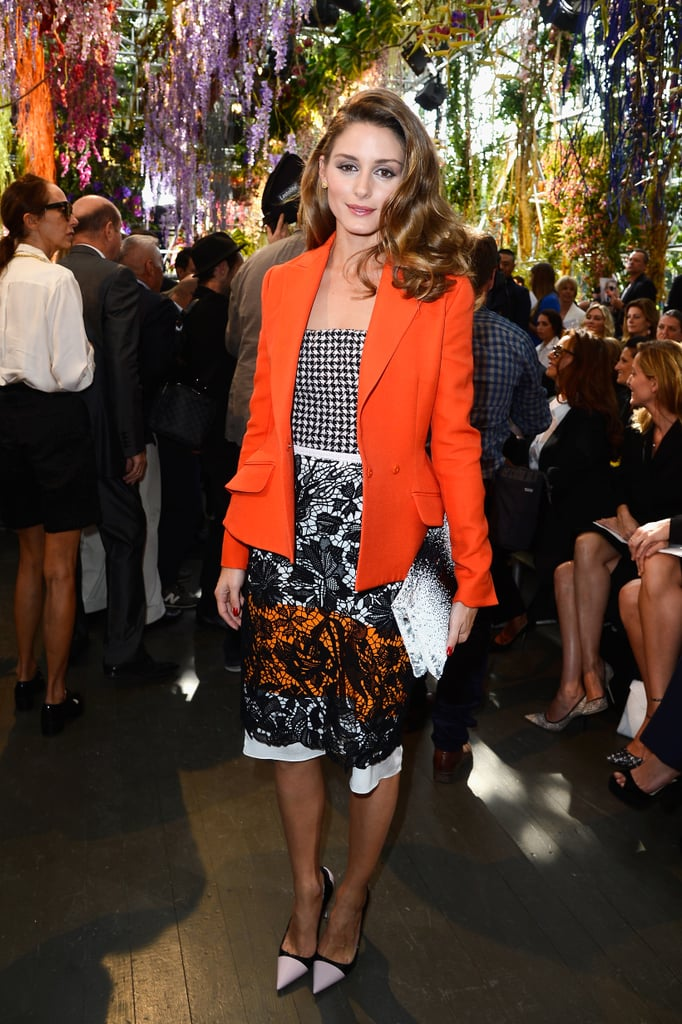 Olivia Palermo brought on the color as she arrived to the Dior Spring show wearing head-to-toe Dior. She started with a lace skirt and houndstooth bustier, then buttoned up in a sleek, bright orange blazer. Finally, she accessorized with a black and white clutch and coordinating shoes.