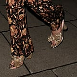 Margot Robbie Pajamas and Gold Loeffler Randall Heels