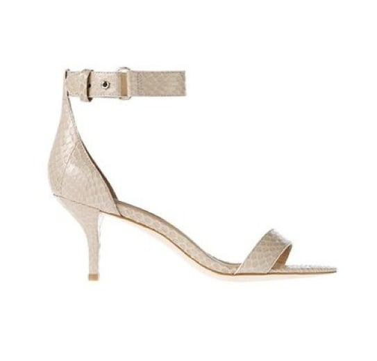 """Dressed up, but low enough so you'll never feel the pain that comes with """"high heels,"""" these Ann Taylor Mara exotic leather kitten-heel sandals ($118) are a pretty ideal pair for the Summer party circuit."""