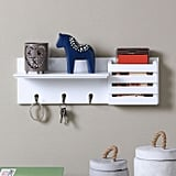 Danya B. Utility Shelf With Pocket and Hanging Hooks in White