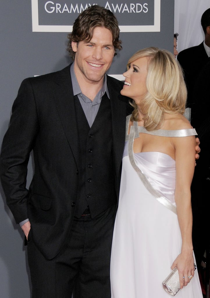 Carrie Underwood and Mike Fisher have been an adorable duo since they started dating in 2008. And while the husband and wife, who got married in July 2010, keep their private lives pretty private, they still manage to share plenty of sweet moments in public. Now that they're parents to their new baby boy, Isaiah Michael, let's take a look back at some of their best snaps including a sexy honeymoon moment and their best social media photos.