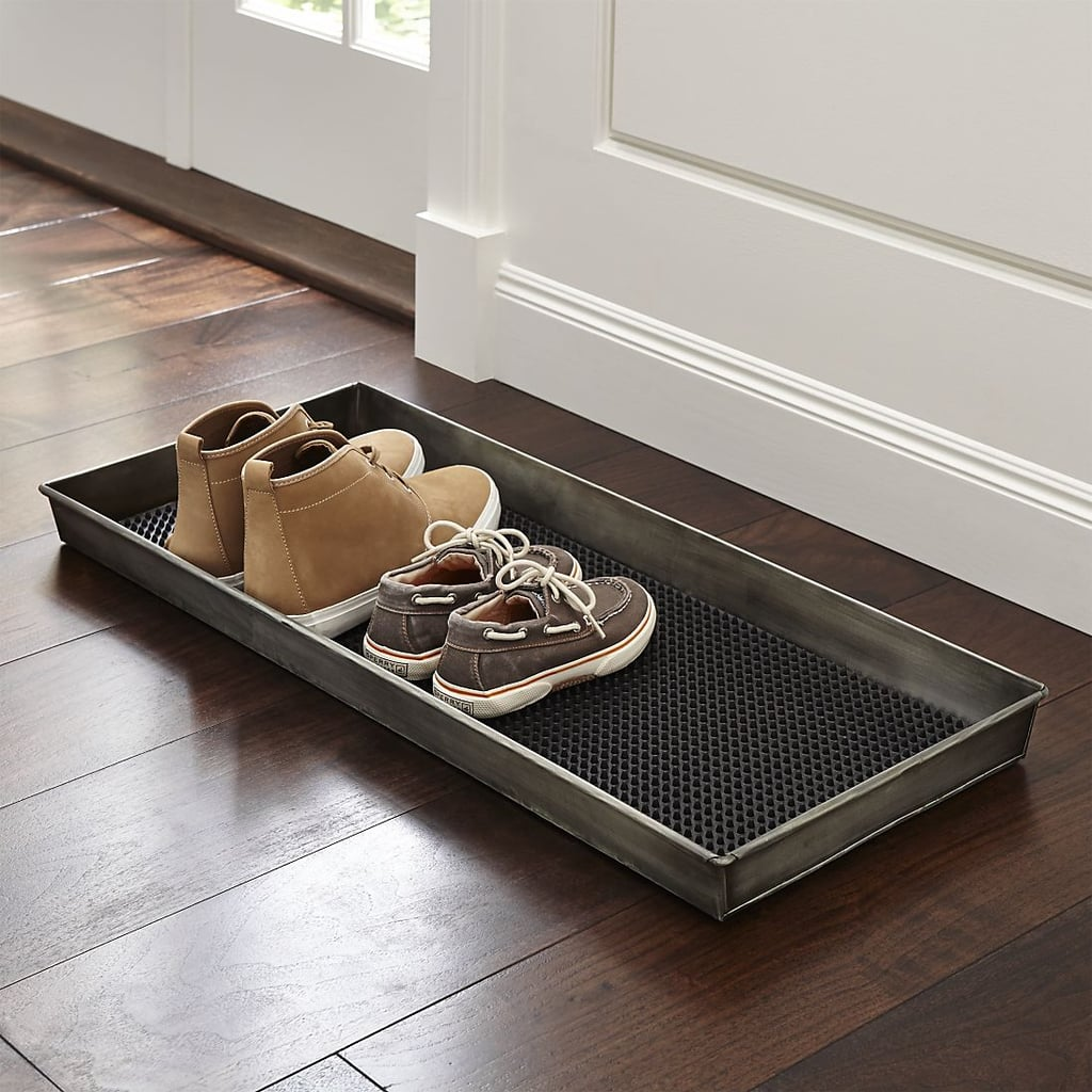 Keep your floors clean by providing an elegant place for guests to ditch shoes, like this zinc boot tray with liner ($40).