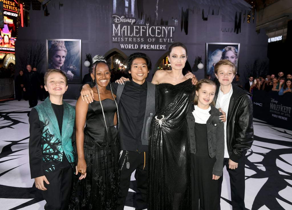 "Angelina Jolie had the full support of her family at the Maleficent: Mistress of Evil premiere on Monday night. The 44-year-old actress brought her kids to the El Capitan theater in Los Angeles, with the exception of 18-year-old Maddox, who is away at college in Singapore.  The mom of six celebrated her big night in a rare public outing with Pax, 15, Zahara, 14, Shiloh, 13, and twins Vivienne and Knox, 11. Her crew looked smiley and happy together as they posed on the red carpet for photos. It's crazy how grown-up they all are!  Earlier this month, Angelina told Hello! magazine that she's ""rediscovering"" herself as a mother of teenagers. ""As they grow up, I find my children are strong individuals but still open-minded,"" Angelina said. ""I try to lead by example and be kind and gracious, as my mother was — and loving and tolerant."" Such valuable advice for any parent.  Catch Maleficent: Mistress of Evil in theaters starting Oct. 18."