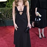 For the Golden Globe Awards in 2004, Jennifer wore a vintage black Valentino gown with a thin strap going across the plunging neckline.