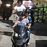 George Clooney drove the scooter while Stacy Keibler sat back and enjoyed the ride.