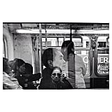 The photographer took a self-portrait in the reflection of a Muni bus window.  Source: Instagram user koci_glass