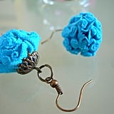 These antique-style rose earrings are actually made from teal-hued recycled fabric in Israel — pretty cool, right? Plus, we think this shade of blue is Spring perfect. Turquoise Vintage Style Earrings ($10)