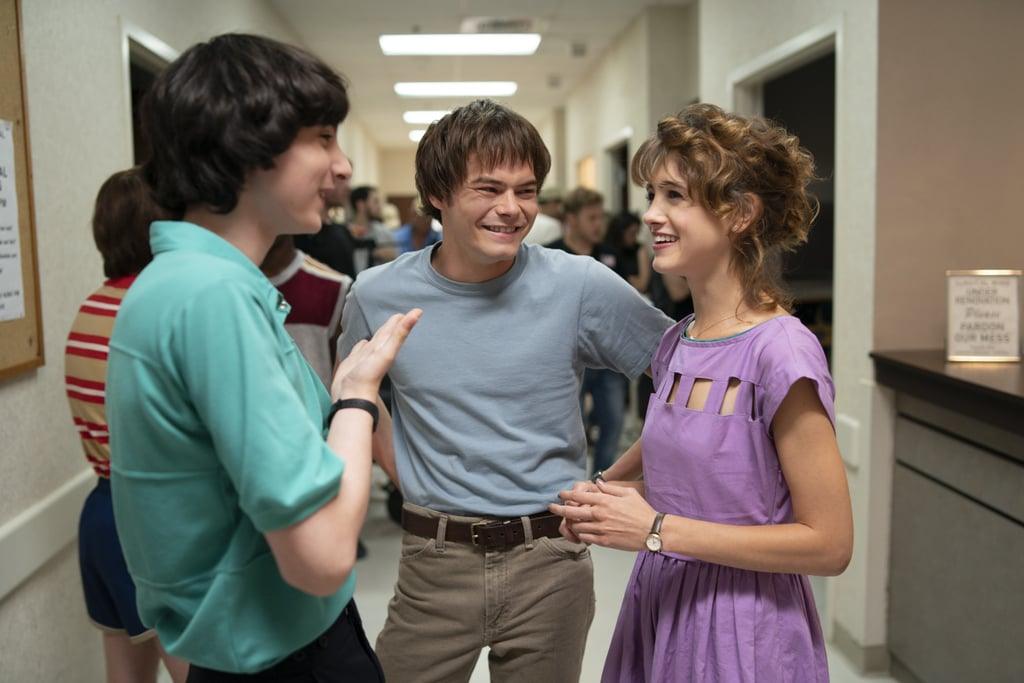 Finn Wolfhard, Charlie Heaton, and Natalia Dyer take a break from battling the Mind Flayer in this shot.