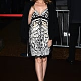 Kylie Minogue donned a wild animal-print dress with a black blazer and strappy sandals at Roberto Cavalli's yacht party at Cannes.