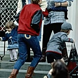 Making a case for the baseball jacket while on a school run with Prince Harry, Diana styled the look with denim jeans, featuring pocket detailing and brown boots.