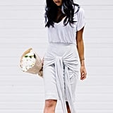 A Slouchy White Tee Tucked Into a Skirt