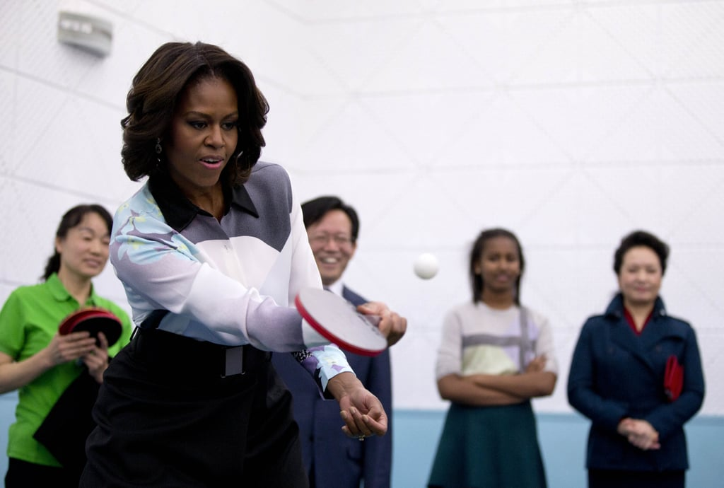 Playing ping-pong like a pro while visiting a school in Beijing during a 2014 official visit.