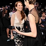 Julianne Moore and Anne Hathaway showed off their statues.