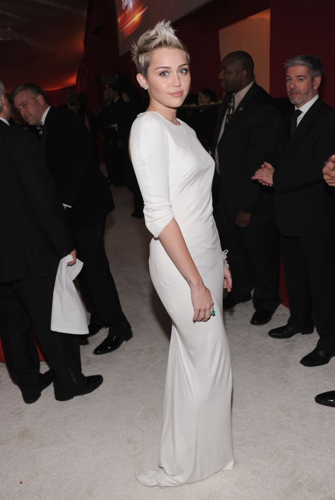 Miley Cyrus posed inside Elton John's Oscar party.