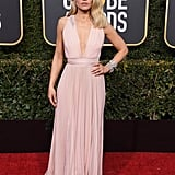 Kristen Bell wearing a plunging Zuhair Murad gown with Harry Winston jewels and Brian Atwood heels.