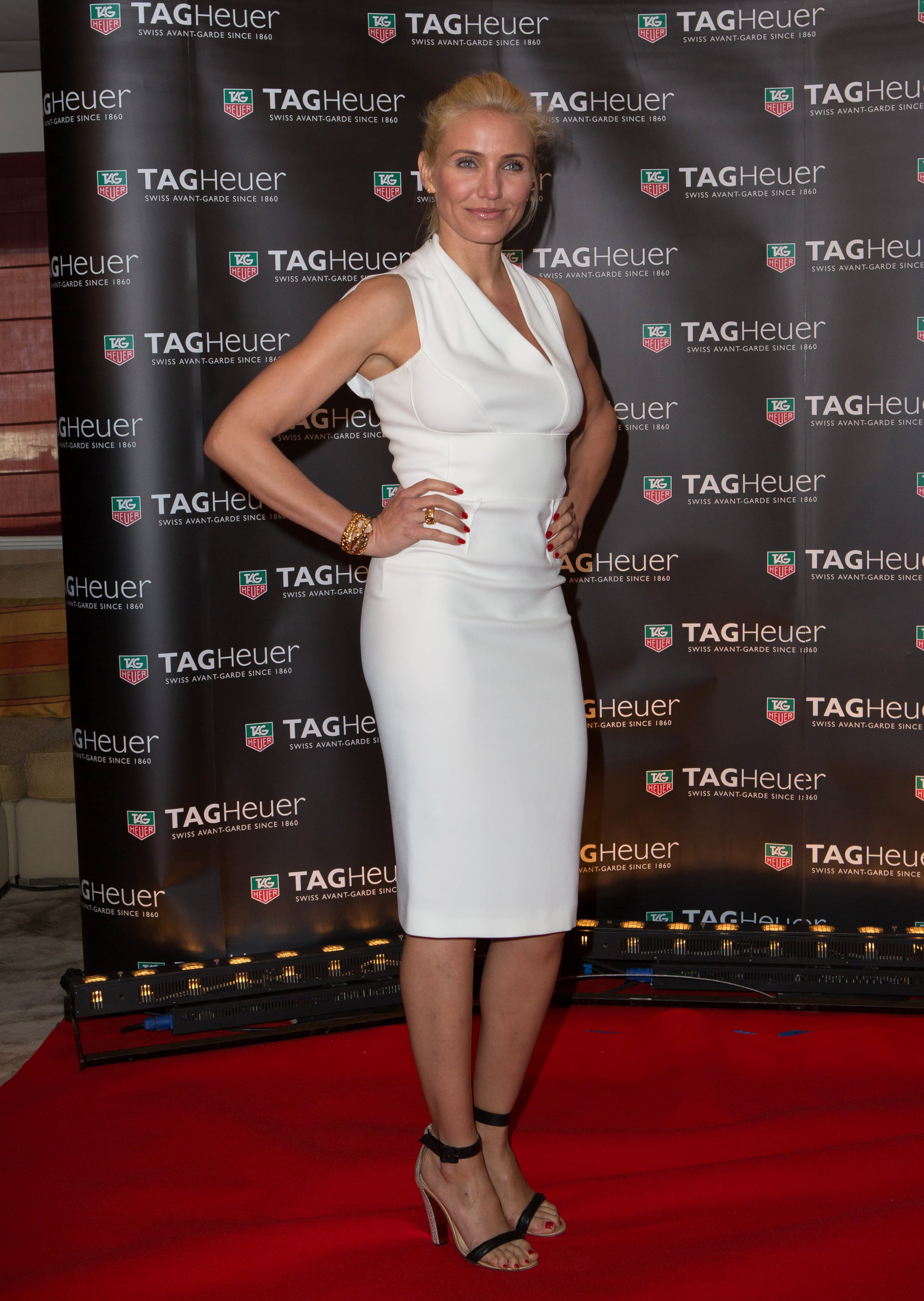 Cameron Diaz posed in a chic, white knee-length dress and black ankle-strap sandals at a Tag Heuer event in Monaco.