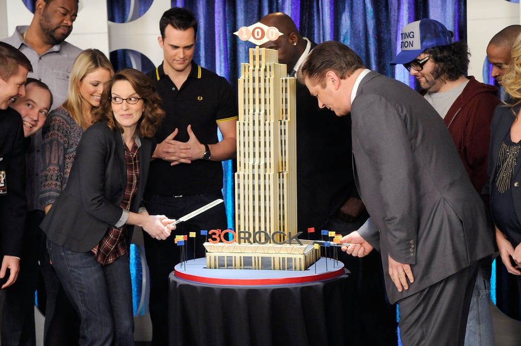 Tina Fey and Alec Baldwin had the honor of cutting a big cake in the shape of 30 Rockefeller Plaza last night as they celebrated the 100th episode of 30 Rock. The duo was joined by Tracy Morgan and Jane Krakowski, who says her pregnancy has made her trendier than ever, and other stars of the show. The celebration wasn't held in the iconic Manhattan building, but across the river at Queens's Silvercup Studios where much of the series is shot. TIna and her cast were the ones celebrating the momentous occasion, but it turns out fans are getting a present too with a special one-hour episode on April 21! It's been a busy few days for Tina in particular, as she balances filming with her philanthropy and writing careers. We weren't treated to a new installment last night, but hopefully they'll be back to owning the Thursday NBC lineup next week.
