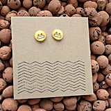 Gritting teeth emoji earrings ($22)