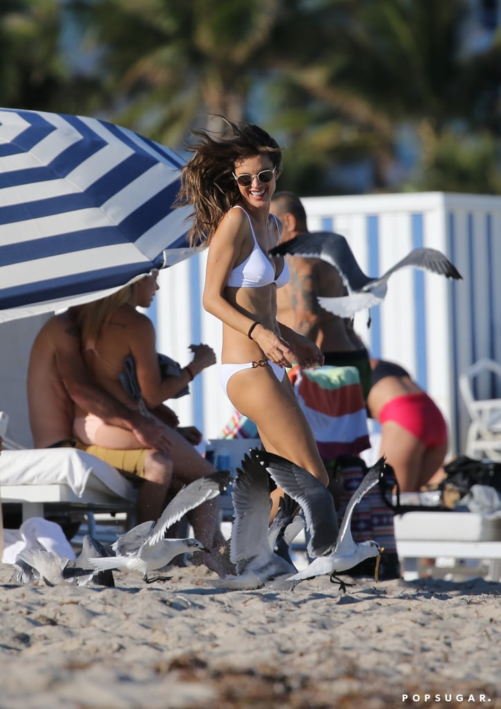 Alessandra Ambrosio is a supermodel; that, we know. And because she's a supermodel, she just so happens to look extraordinarily hot in a bikini — no matter the circumstances. On Tuesday, the Victoria's Secret Angel proved that nothing can come between a girl and her snacks while kicking back on the beach in Miami; as Alessandra was minding her own business and eating some french fries, a rowdy pack of seagulls descended on her. As she got up to walk away, they followed her around the beach, possibly to find out what Victoria's secret really is or to ask why she wasn't wearing her wings.  Anyway, Alessandra held her own, laughing off the attack while still looking ridiculously sexy in her white two-piece. She even posed for a few Instagram snaps with her new feathered friends in the background. Scroll through to see all the photos from Ale's hilarious beach day, then check out her best Victoria's Secret Angel photos before she hits the runway this month.      Related:                                                                                                           Alessandra Ambrosio's Sexy Bikini Photos Are Sure to Make You Hyperventilate