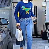 While out in LA, Selena played around with mixing different pieces in this Coach sweater with a Wolford bodysuit underneath, Vetements jeans, Coach purse, and Kurt Geiger shoes.