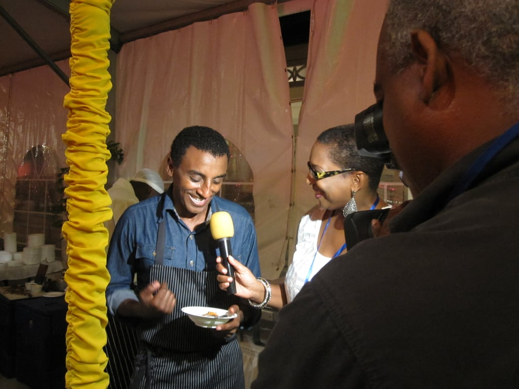 This shot perfectly illustrates how big of a star, Marcus Samuelsson, winner of Top Chef Masters Season 2, is.