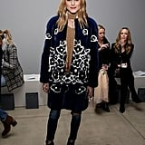 At the Zimmermann show, Olivia dressed up denim simply by adding a statement coat. Lesson learned.