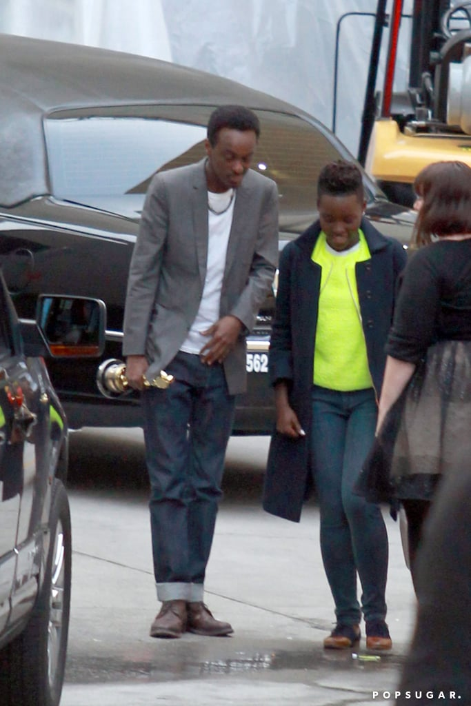 "Lupita Nyong'o was on Live! With Kelly and Michael just after winning her Oscar, and what's more exciting is what we saw when she left! Lupita cuddled up to Somali rapper K'naan, who was holding her Oscar tight in his other hand. Throughout award season, wherein Lupita's been sweeping everyone off their feet with award and red carpet victories alike, rumors have been swirling about her love life. Many thought she was dating fellow award season darling Jared Leto, who went so far as to call Lupita his ""future ex-wife"" in his Spirit Awards acceptance speech. It looks like we have our answer, though, and it also looks like Lupita's just as content with her real man as she is with her little golden man. Source: Coleman-Rayner"