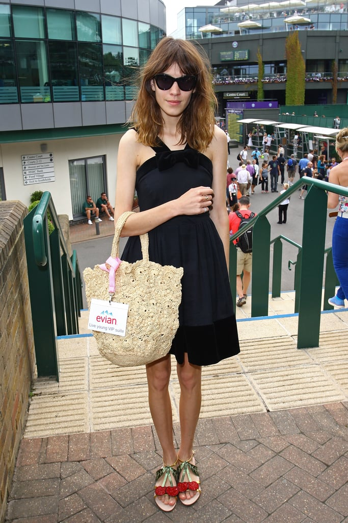 Alexa Chung brought a girlie, fun sensibility to a daytime LBD with a straw tote and adorable cherry sandals.